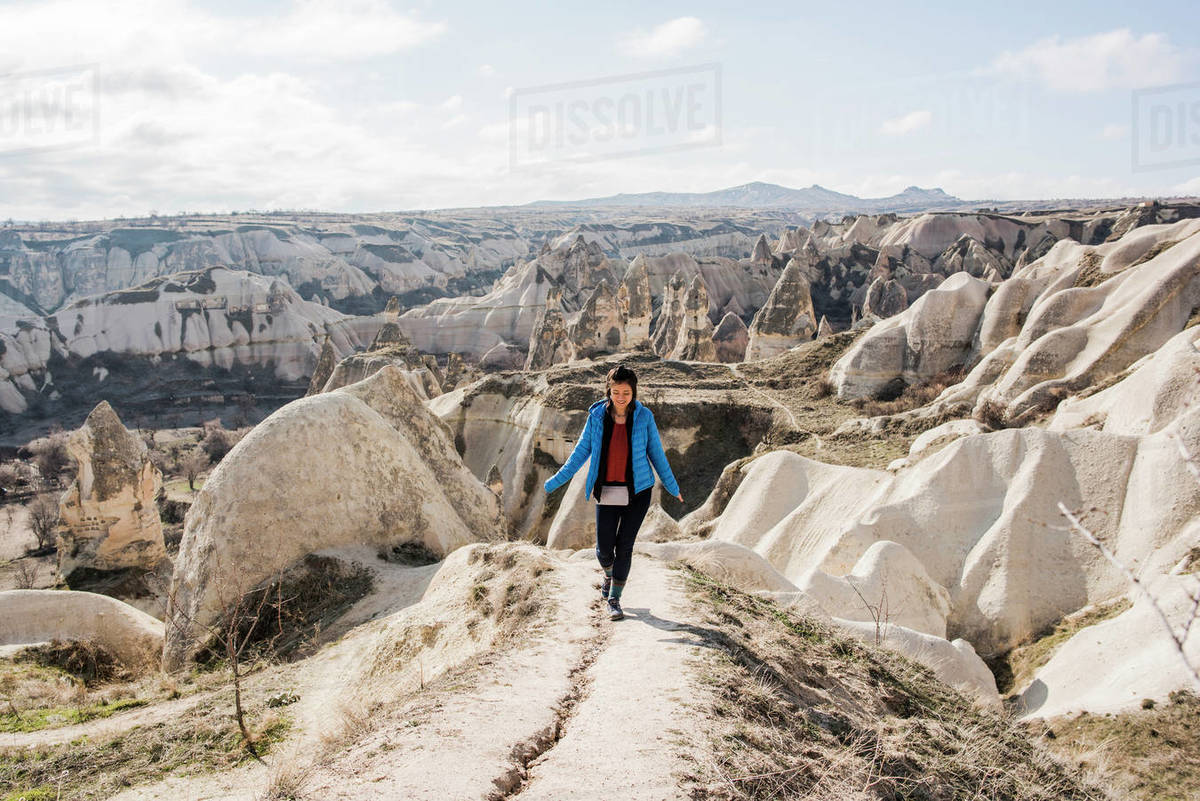 Woman hiking in rocky valley, Göreme, Cappadocia, Nevsehir, Turkey Royalty-free stock photo