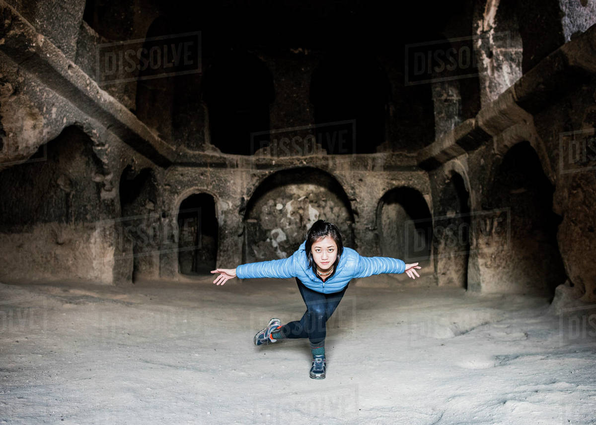 Woman practising yoga in Selime Monastery, Göreme, Cappadocia, Nevsehir, Turkey  Royalty-free stock photo