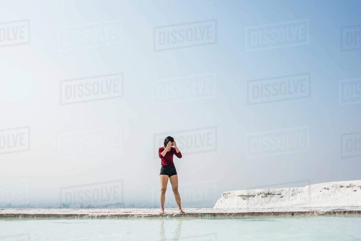 Woman looking down at thermal pool, Pamukkale, Denizli, Turkey  Royalty-free stock photo