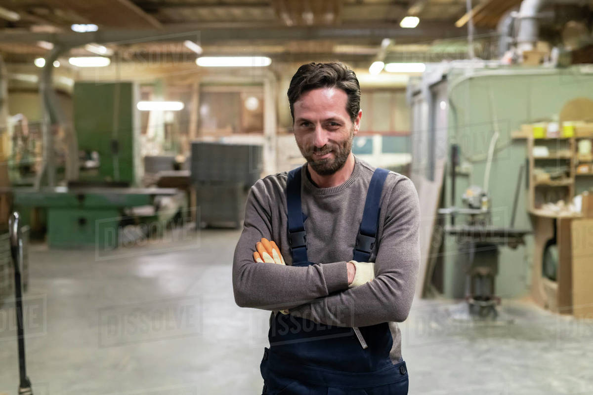 Worker with arms crossed in factory Royalty-free stock photo