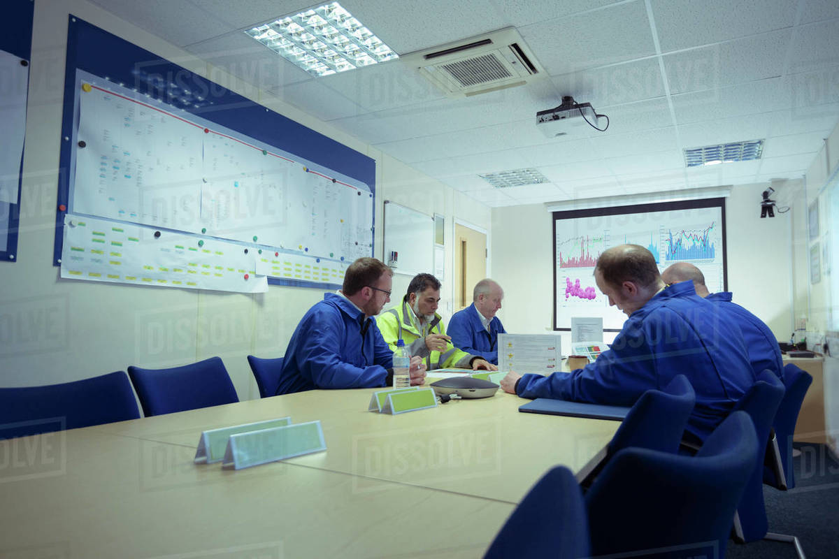 Engineers in a meeting in a nuclear power station. Royalty-free stock photo