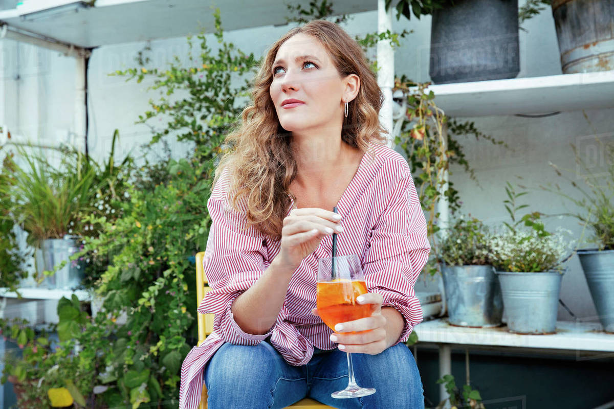 A woman sitting on a terrace having a drink Royalty-free stock photo