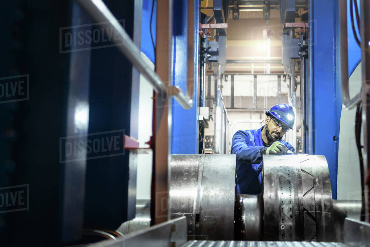 An engineer inspecting a turbine shaft in a nuclear power station. Royalty-free stock photo