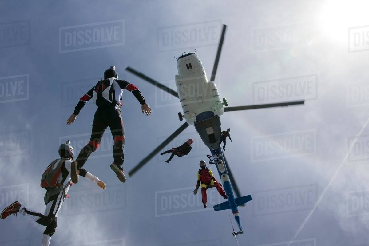 Low angle view of helicopter and six skydivers free falling, Siofok, Somogy, Hungary Royalty-free stock photo