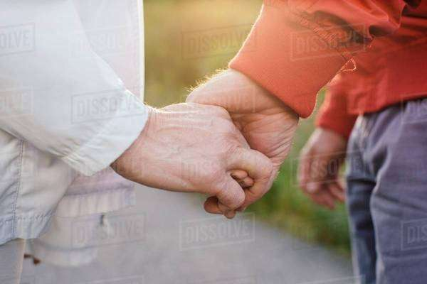 Senior couple holding hands, close up Royalty-free stock photo