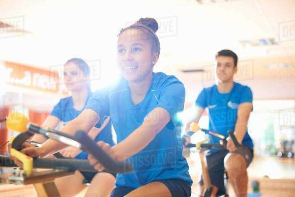 Young woman on exercise bike Royalty-free stock photo