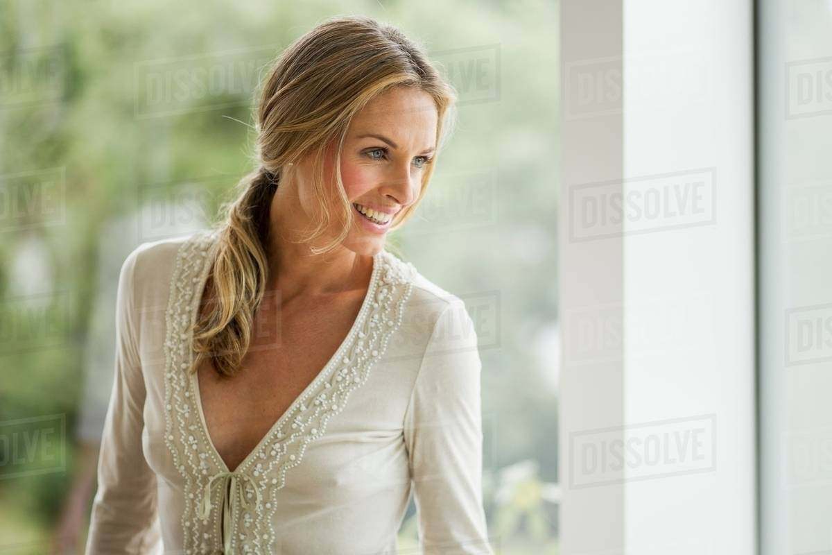 Mature Blonde Woman Looking Away, Portrait - Stock Photo -2485