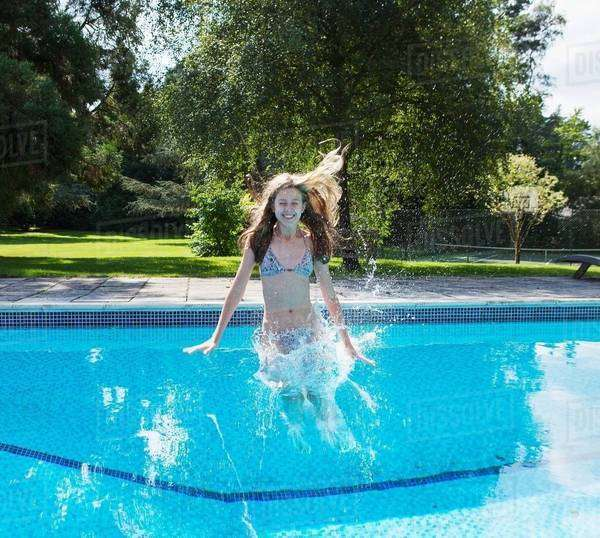 Girl jumping into swimming pool Royalty-free stock photo