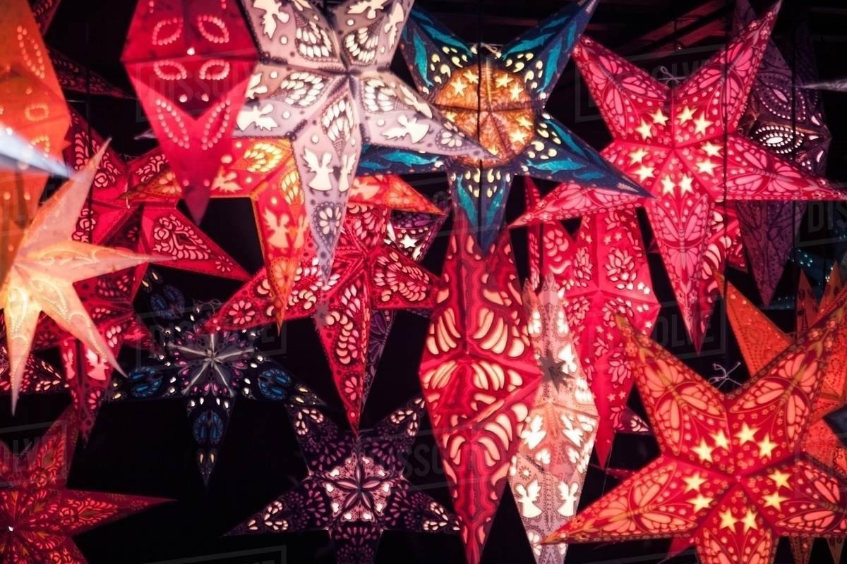 Close up of star shaped lantern xmas decorations on German Christmas market stall