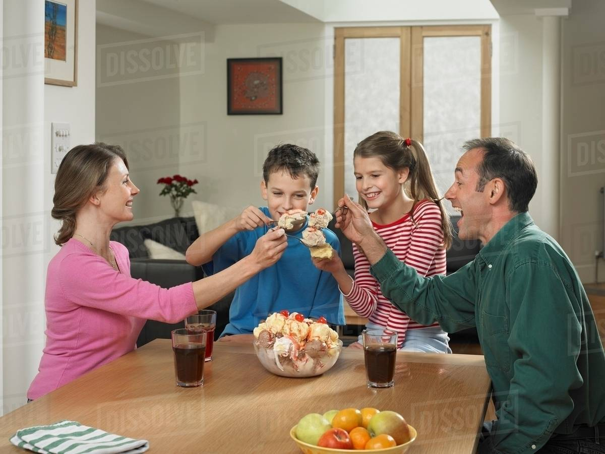 Family eating ice cream together - Stock Photo - Dissolve