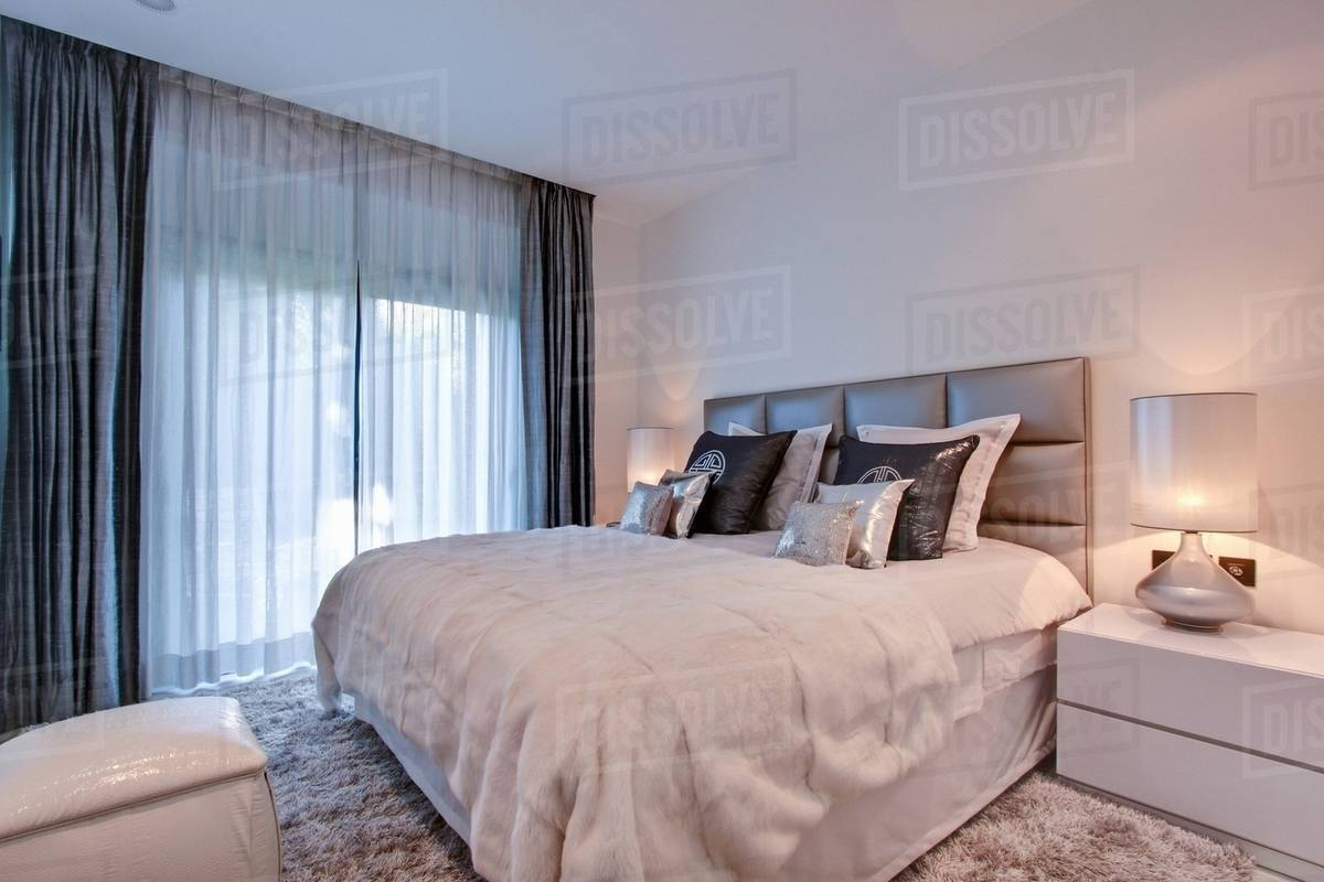 Sheer Curtains In Bedroom Stock Photo