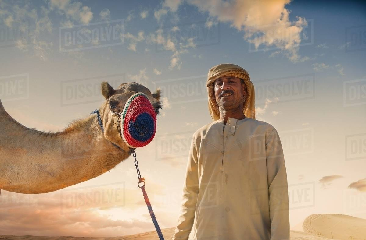 Portrait of camel and bedouin in desert dubai united arab emirates portrait of camel and bedouin in desert dubai united arab emirates altavistaventures Choice Image