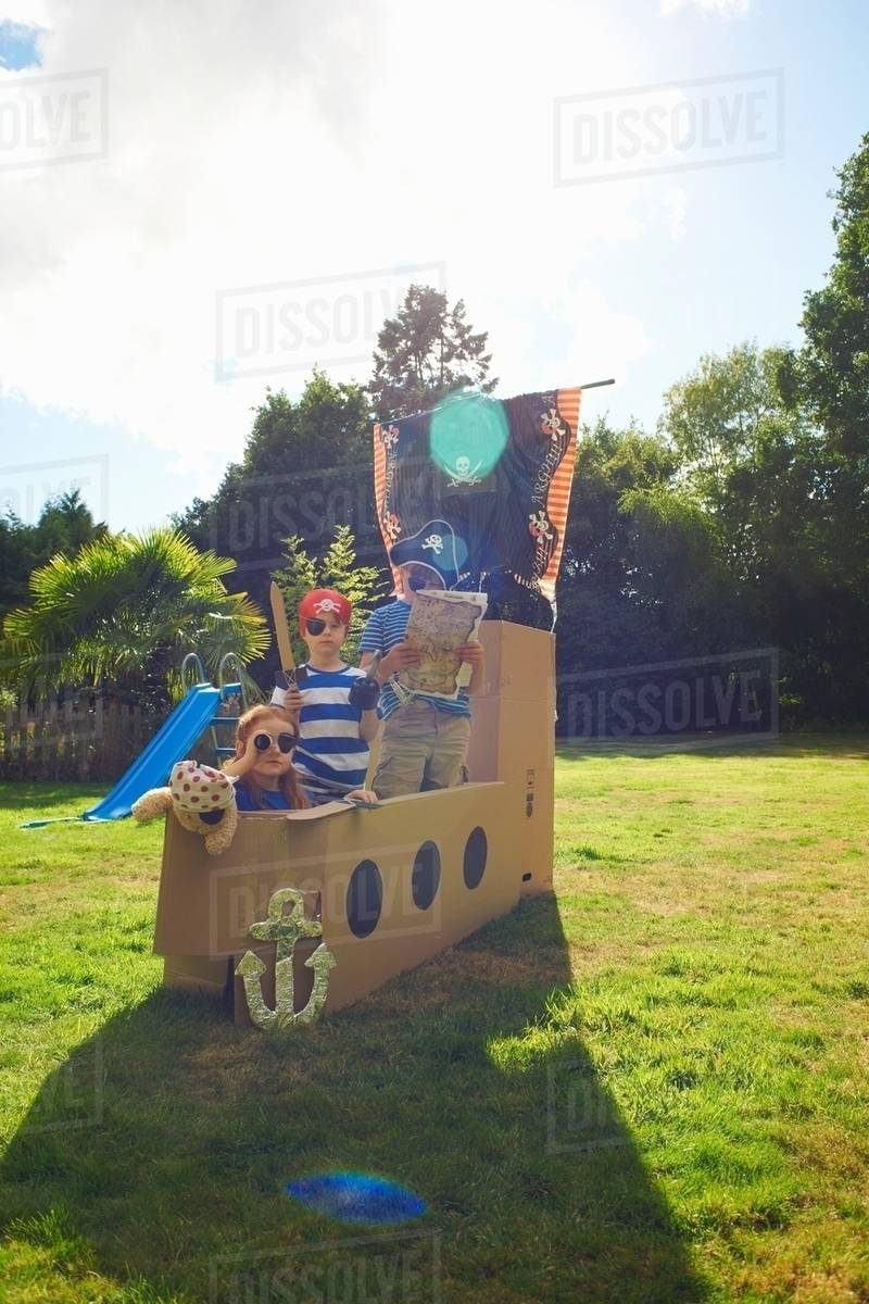 Superieur Two Brothers And Sister Playing In Garden With Homemade Pirate Ship