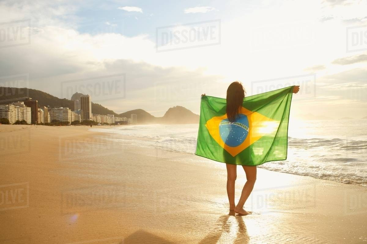 Woman Holding Brazilian Flag On Copacabana Beach Rio Brazil
