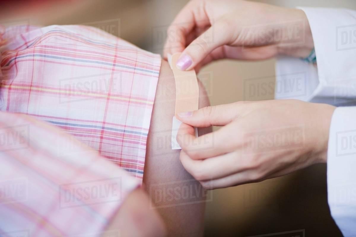 Plaster/bandage put on knee, close up stock photo