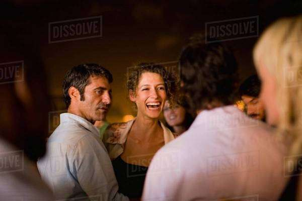 Woman laughing at party at night Royalty-free stock photo