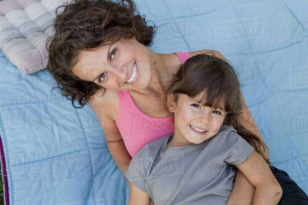 Mother and daughter relaxing on blanket Royalty-free stock photo