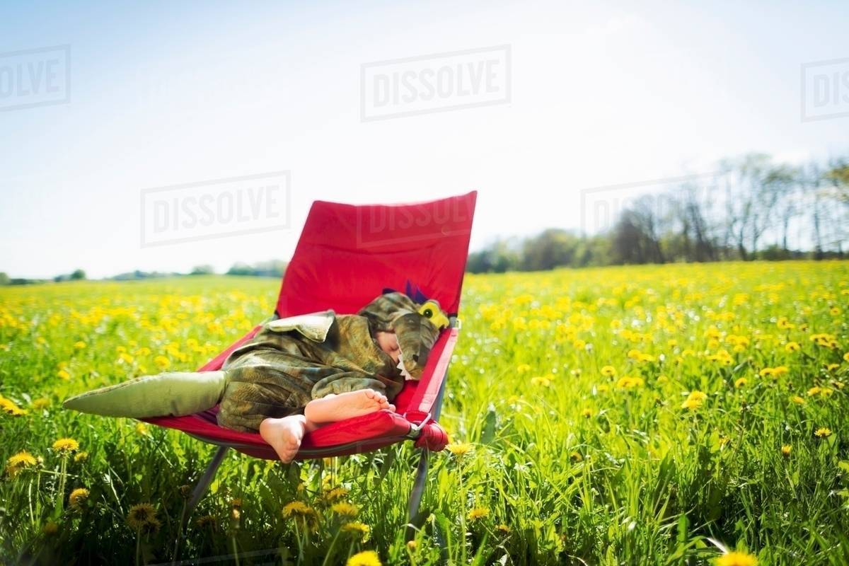 Boy in costume sleeping in chair Royalty-free stock photo
