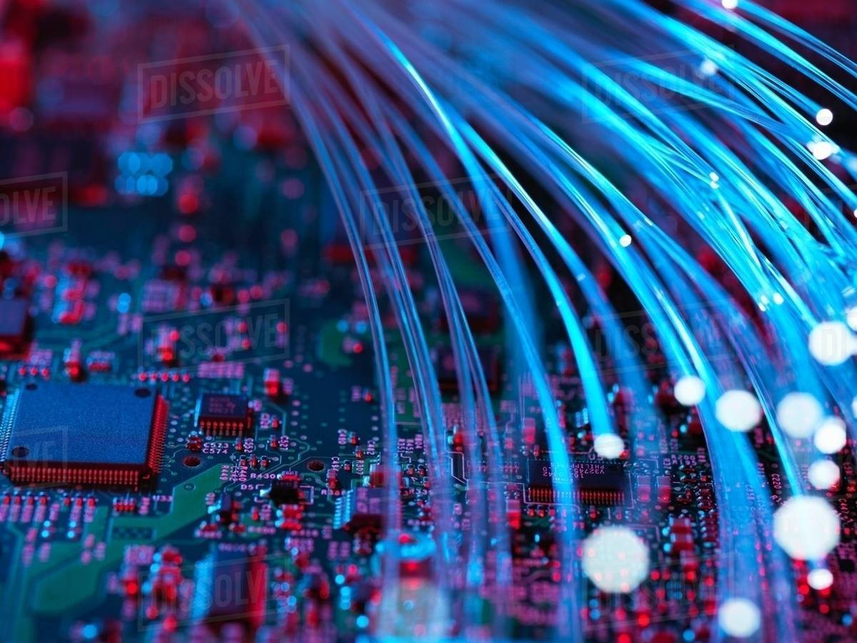 Fibre Optics Flowing Through Circuit Boards From A Laptop Computer Board With Electronic Components Inside Stock Photo Close Up