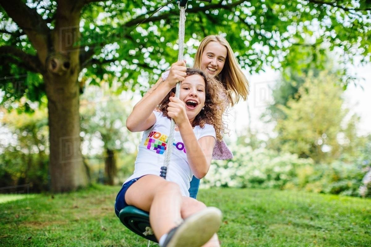 Girls swinging with girls theme