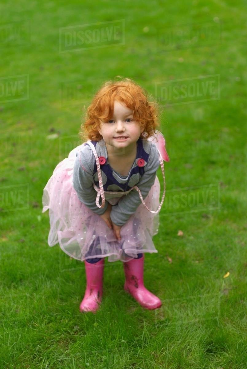 Young girl smiling in garden Royalty-free stock photo