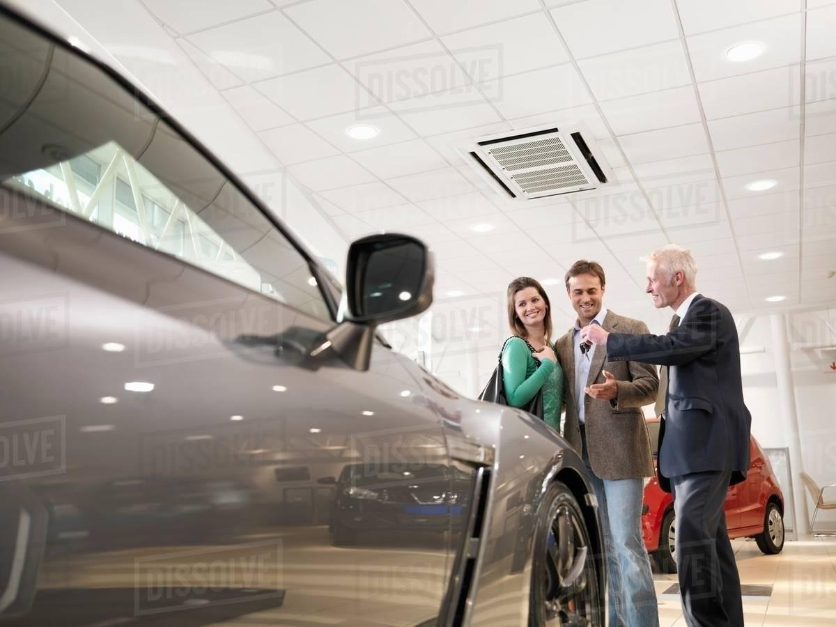 Key Car Dealership >> Salesman Handing Customers Keys To A Car In Car Dealership D943 93 418