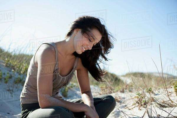 Girl playing with sand Royalty-free stock photo