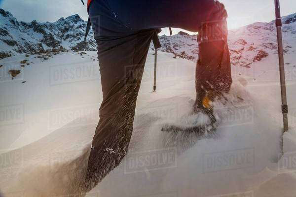 Climber wearing snow shoes walking through deep snow, Monte Rosa, Piedmont, Italy Royalty-free stock photo