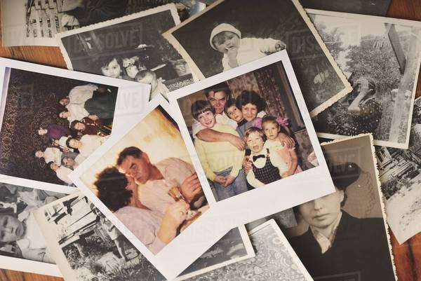 Pile of family photographs on table, overhead view Royalty-free stock photo