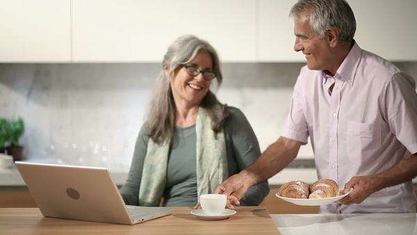Happy couple with laptop in the kitchen; Full Hd Photo JPEG Royalty-free stock video