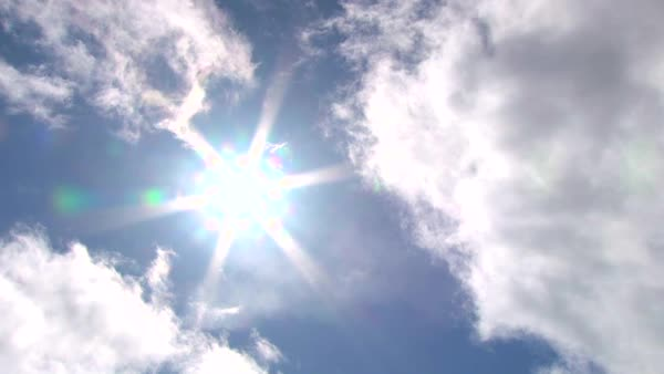 timelapse of sun break between two clouds with blue sky. Royalty-free stock video