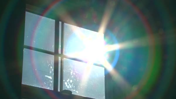 Sun shines bright through window, zoom in with science fiction warp effect. Royalty-free stock video