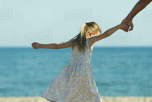 Little Girl Standing Naked At The Beach, Rear View - Stock Photo - Dissolve-8522