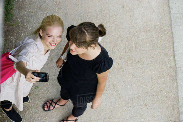 Young women posing for cell phone picture Royalty-free stock photo