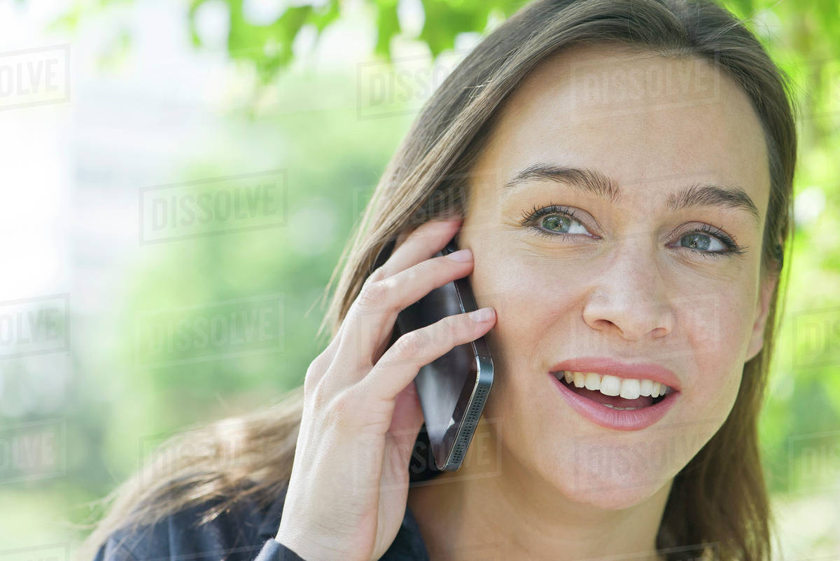 Woman talking on smartphone Royalty-free stock photo