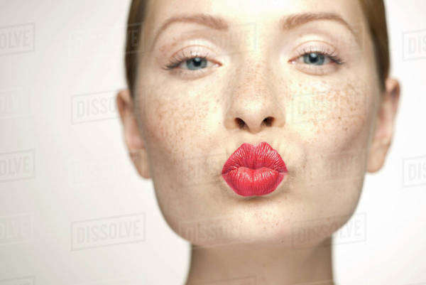Young woman puckering lips, portrait Royalty-free stock photo