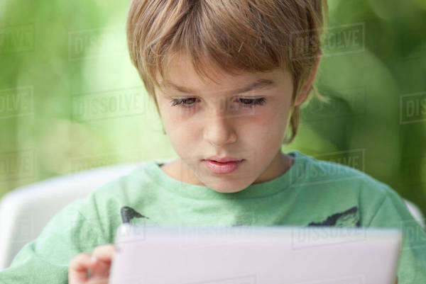 Boy using digital tablet Royalty-free stock photo