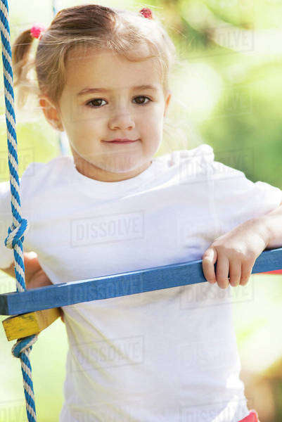 Little girl playing on jungle gym Royalty-free stock photo