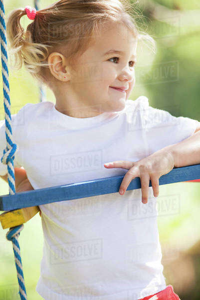 Little girl on jungle gym Royalty-free stock photo