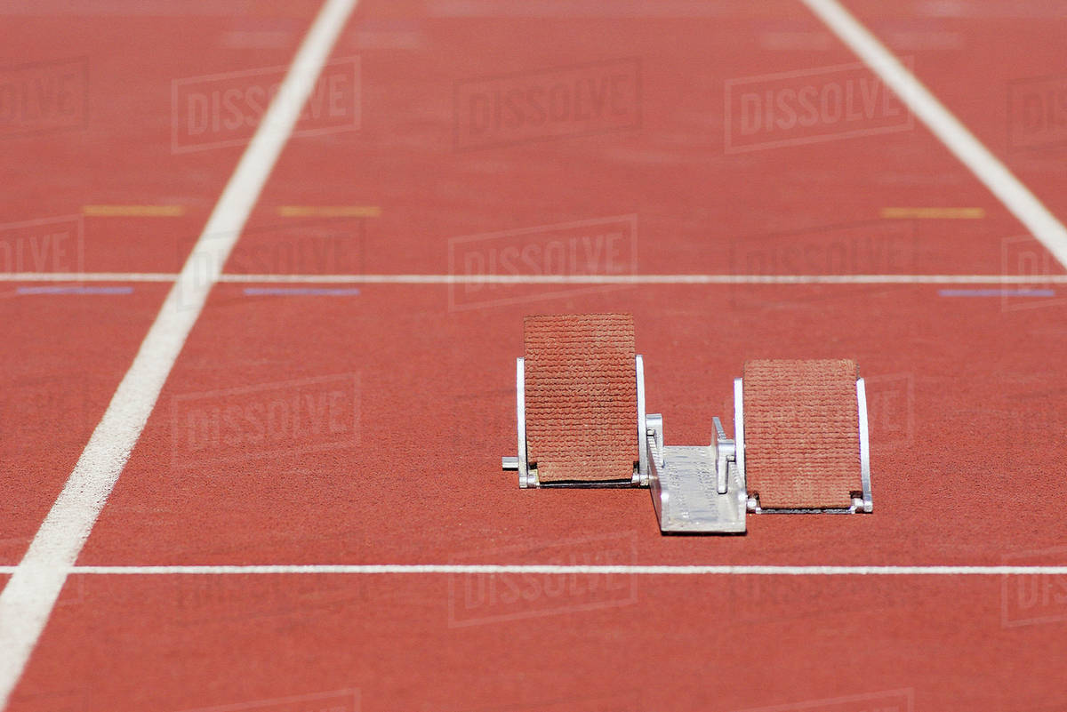 starting blocks on running track stock photo dissolve
