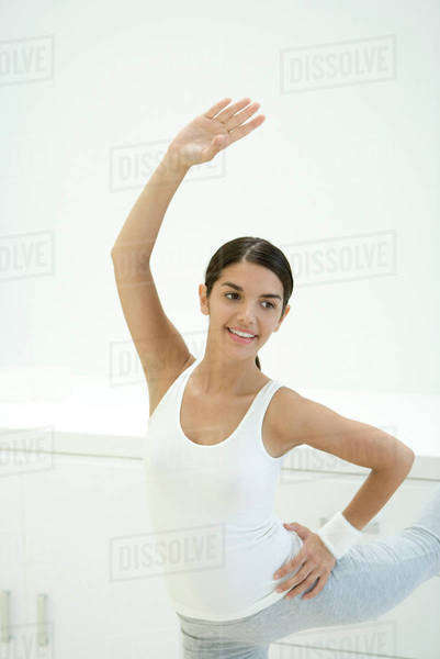 Woman stretching, one arm raised Royalty-free stock photo
