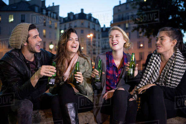 Friends having beers together outdoors Royalty-free stock photo