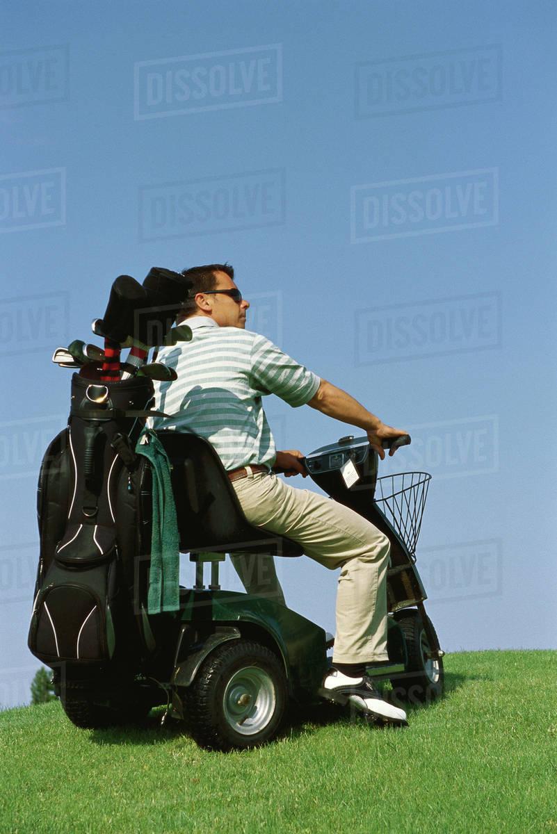 Electric Golf Caddy >> Golfer Driving Electric Golf Caddy Stock Photo