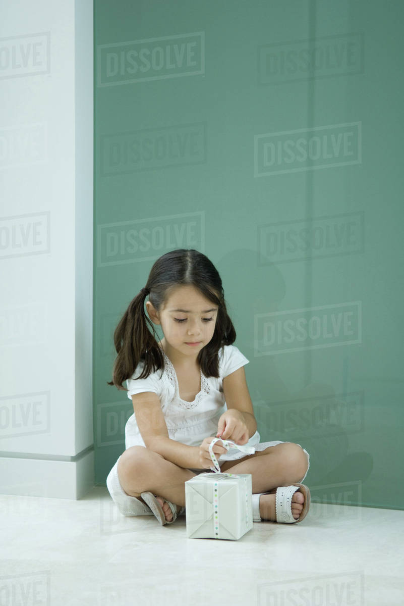 little girl sit ground Little girl sitting on the ground after she fell while ...