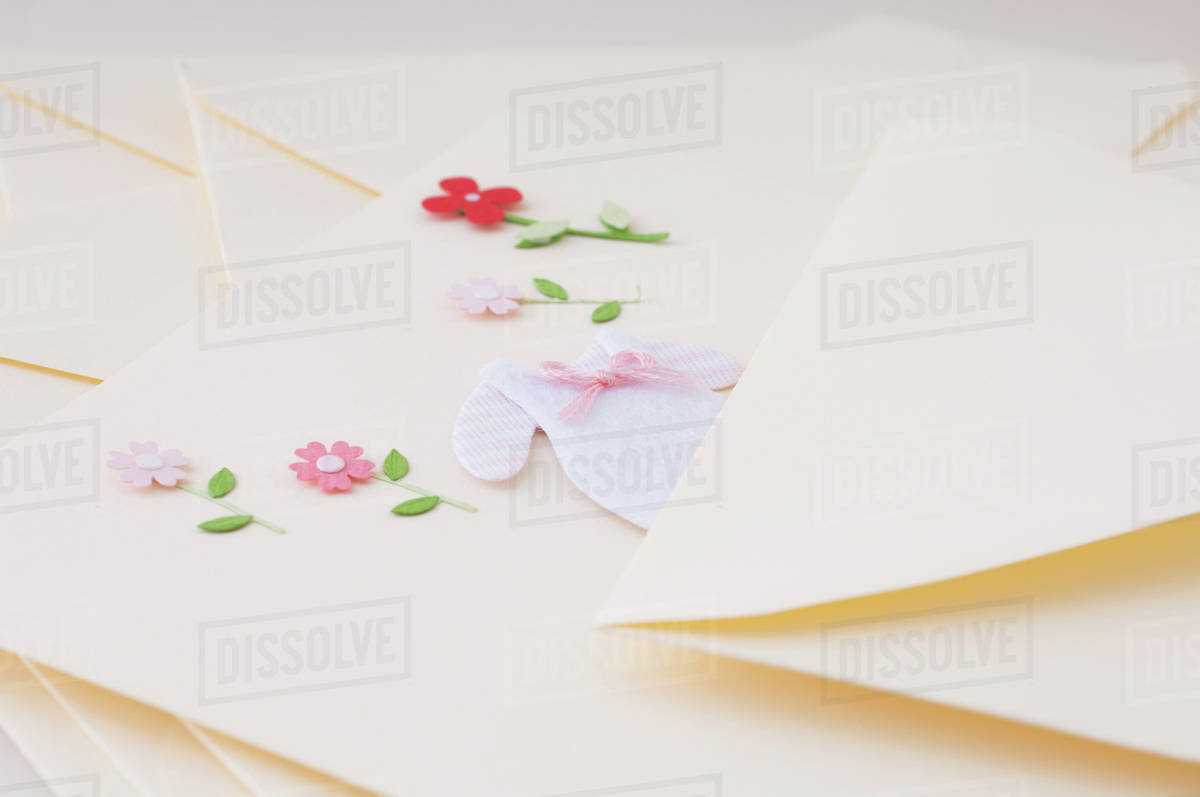 6f71d2a6c9 Stationery embellished with miniature baby clothing and flowers ...