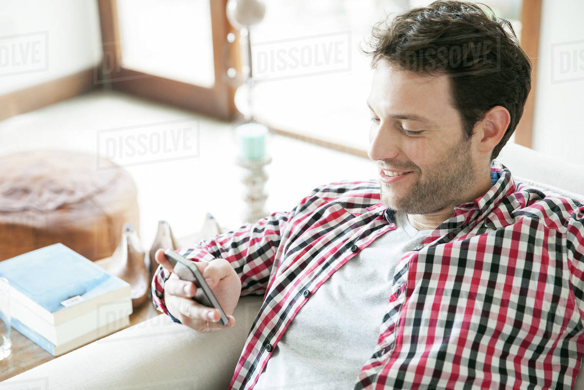 Man using smartphone at home Royalty-free stock photo