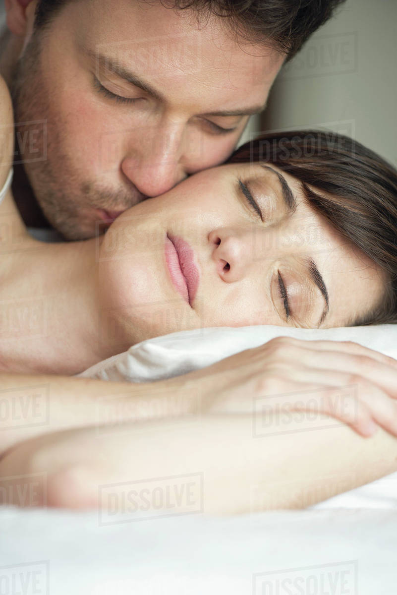Together In Bed Husband Kissing Wife S Cheek