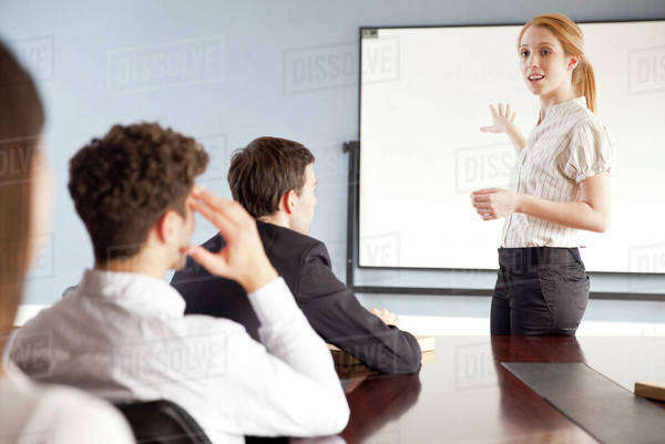 Businesswoman giving presentation at corporate meeting Royalty-free stock photo
