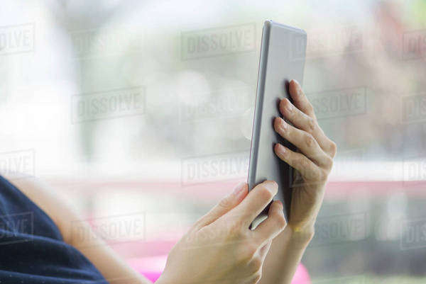Woman using digital tablet, cropped Royalty-free stock photo