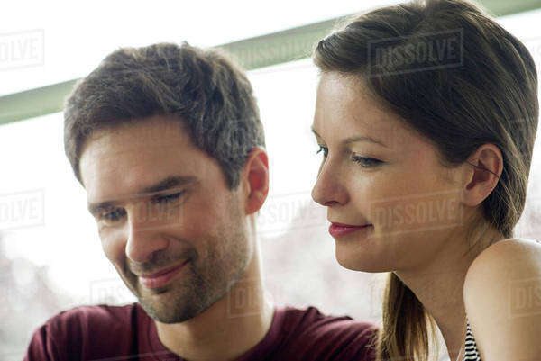 Couple relaxing together, both smiling Royalty-free stock photo